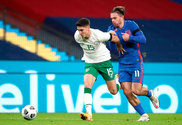 HUNTED DOWN: Callum O'Dowd is chased by England's Jack Grealish at Wembley
