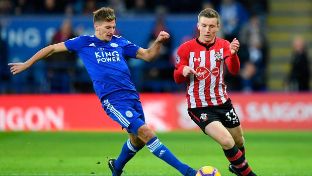 Leicester's Marc Albrighton of Leicester City and Southampton's Matt Targett battle for possession. Photo: Getty Images