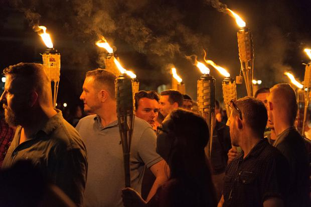 White nationalists carry torches on the grounds of the University of Virginia, on the eve of a planned Unite The Right rally in Charlottesville, Virginia, U.S. August 11, 2017. Picture taken August 11, 2017. Alejandro Alvarez/News2Share via REUTERS.