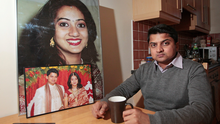 Savita Halappanavar's husband Praveen sits with a photograph of his wife at a friend's house in Galway.