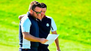 Rory McIlroy consults with European vice-captain Graeme McDowell. Photo: Ramsey Cardy/Sportsfile