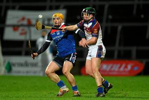 WIT's Liam McGrath in action against Eoin Moriarty of UL during the Fitzgibbon Cup final at the Gaelic Grounds in Limerick. Photo: Diarmuid Greene / SPORTSFILE