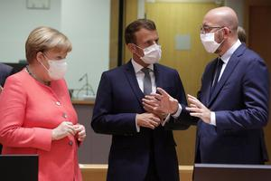 Germany's Chancellor Angela Merkel, French President Emmanuel Macron and European Council President Charles Michel talk at the start of the first face-to-face EU summit since the coronavirus disease outbreak, in Brussels, Belgium July 17, 2020. Stephanie Lecocq/Pool via REUTERS