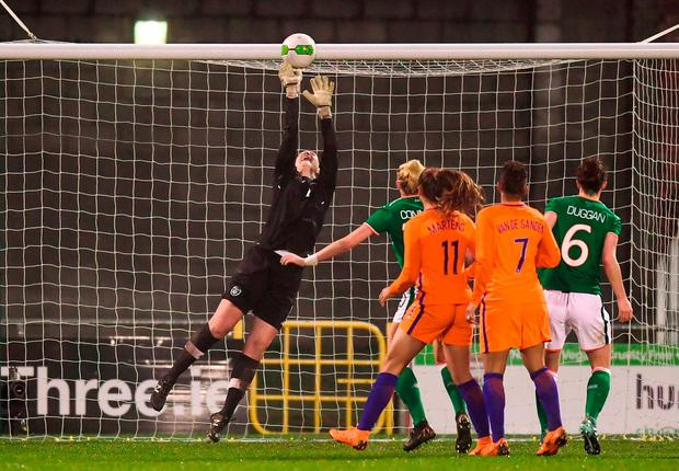 Marie Hourihan tips the ball over the bar. Photo: Stephen McCarthy/Sportsfile