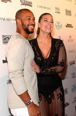Justin Ervin (L) and model Ashley Graham attend the Sports Illustrated Swimsuit 2016 Swim BBQ VIP at 1 Hotel & Homes South Beach on February 17, 2016 in Miami Beach, Florida.  (Photo by Gustavo Caballero/Getty Images for Sports Illustrated)