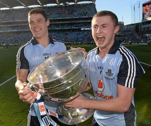 Dublin's Diarmuid Connolly, left, and Jack McCaffrey celebrate with the Sam Maguire Cup following their side's victory over Mayo at Croke Park on September 22, 2013