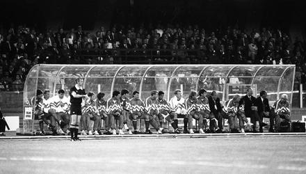 Waiting in vain: The Irish bench watches the opening game against England anxiously but six members of the squad – Gerry Peyton, Chris Hughton, David Kelly, Frank Stapleton, Bernie Slaven and John Byrne – wouldn't see a minute of action in Italy.