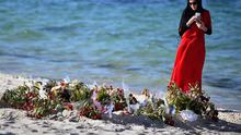 SOUSSE, TUNISIA - JUNE 30:  A woman looks at flowers laid on Marhaba beach in Sousse, where 38 people were killed in last Fridays terror attack on June 30, 2015 in Sousse, Tunisia. Photo by Jeff J Mitchell/Getty Images