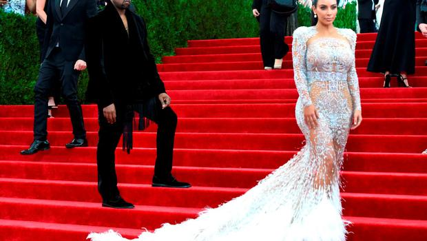 Yes, Kim was pregnant wearing this Cavalli couture feathered number to the Met Gala in May.