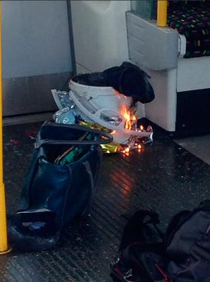 A Metro.co.uk reporter at the scene was quoted by the paper as saying that a white container exploded on the train and passengers had suffered facial burns.