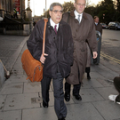 Lest we forget: Ajai Chopra (left), deputy director of the IMF European Department, makes his way to the Central Bank HQ on Dame Street, Dublin, in 2011. Photo: Frank McGrath