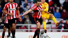 Lazar Markovic of Liverpool battles for the ball with John O'Shea of Sunderland during the Barclays Premier League match between Sunderland and Liverpool at Stadium of Light