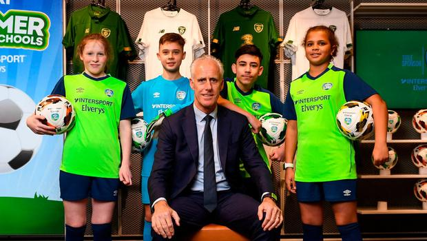 The kids are alright: Ireland manager Mick McCarthy with Larkin Community College students (l-r) Isabelle Baker, Adrian Lucaci, Remis Galiceanu and Alisha Rose Sammy at INTERSPORT Elverys, Henry Street in Dublin. McCarthy, however, has said he is likely to rely on experience for the play-off against Slovakia. Photo: Stephen McCarthy/Sportsfile