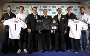 Cross purposes: Real Madrid's Florentino Perez holds the credit card with no Christian cross on the club crest