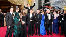 Best Oscars photo-bomb? Actor Benedict Cumberbatch jumps behind U2 at the 86th Academy Awards