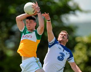 Conor McNamee gets to the ball ahead of Waterford's Craig Guiry