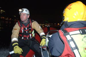 17/03/15.Firefighter Rory Foy on the Dublin Fire Brigade rescue boat patrolling the River Liffey Dublin on St.Patricks night. Pic: Justin Farrelly.