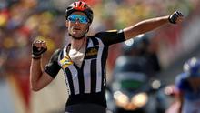 MTN-Qhubeka rider Stephen Cummings of Britain celebrates as he crosses the finish line to win the 178.5-km (110.9 miles) 14th stage of the 102nd Tour de France cycling race from Rodez to Mende, France, July 18, 2015.  REUTERS/Benoit Tessier  TPX IMAGES OF THE DAY