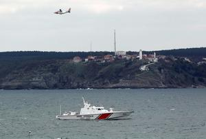 A Turkish Navy's coastguard ship and a plane carry out a search and rescue operation after a boat sank in the Bosphorus strait, off the Black Sea village of Garipce near Istanbul REUTERS/Osman Orsal
