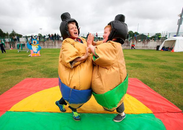 Rhian Crowe and Brandon Lee from Cavan try out the Sumo wrestler suits. Picture Credit : Frank Mc Grath
