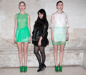 She poses with Simone Rocha with natural grace