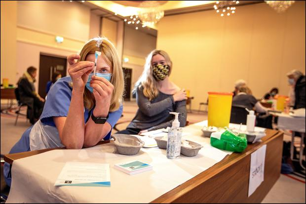 VITAL VIALS: Vaccinator Olive Hanley preparing a jab yesterday in the centre that has been set up at the Carlton Hotel, Tyrrelstown, Dublin. Photo: David Conachy