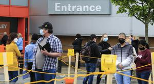 People queue outside the B&Q store in Liffey Valley. Picture; Gerry Mooney