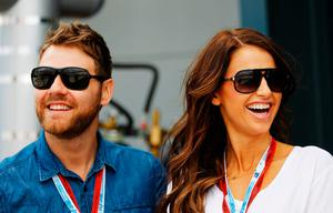 Brian McFadden and Vogue Williams are seen outside the Red Bull Racing garage before the Australian Formula One Grand Prix at the Albert Park circuit on March 18, 2012 in Melbourne, Australia.  (Photo by Paul Gilham/Getty Images)