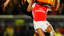 Hull's Paul McShane gets a foot up on Arsenal's Alexis Sanchez during last night's league clash