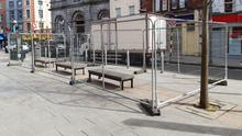 Seating on West Street is fenced off