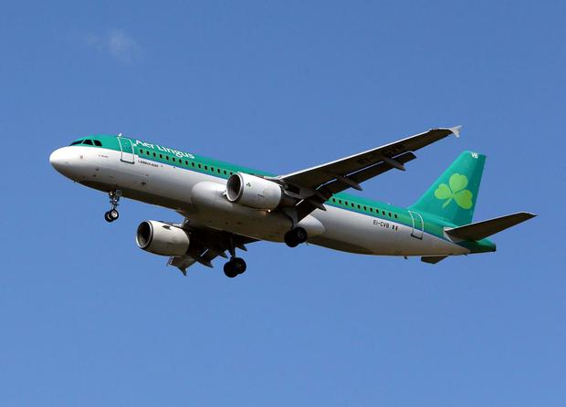 An Aer Lingus plane over Heathrow, which is a British Airways hub