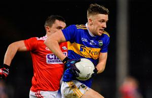Riain Quigley of Tipperary in action against Seán Powter of Cork. Photo: Piaras Ó Mídheach/Sportsfile