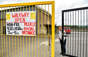 OPENING UP: Tadhg Donavan, Chairman of Buttevant GAA Club, opens the gates to walkers at Buttevant GAA club in Cork, after walkways in GAA clubs opened to members of the public for exercising yesterday. Photo: Eóin Noonan/Sportsfile