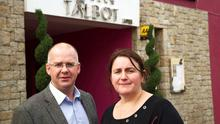 LOCATION, LOCATION, LOCATION: Tom and Orla Talbot outside their hotel in the town Photo : Keith Heneghan