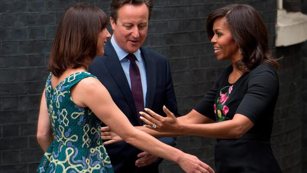 Prime Minister David Cameron (centre) and his wife Samantha (left) greet Michelle Obama outside 10 Downing Street, London. PRESS ASSOCIATION Photo. Picture date: Tuesday June 16, 2015. Mrs Obama is visiting Britain to discuss her campaigns for girls' education and better support for military families. See PA story POLITICS Obama. Photo credit should read: Stefan Rousseau/PA Wire