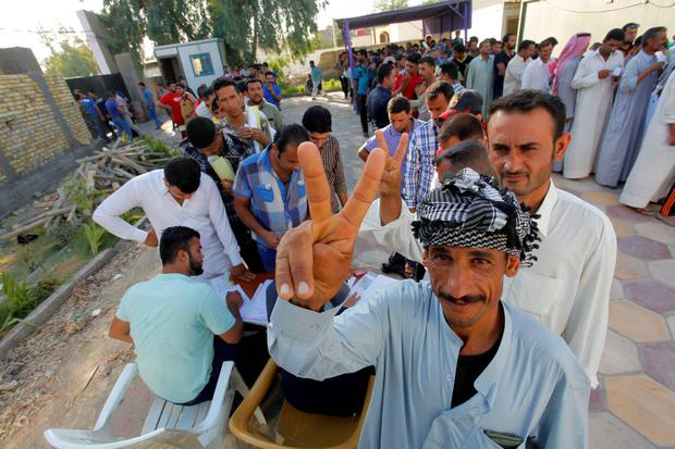 A volunteer who is going to join the Iraqi army to fight against the predominantly Sunni militants who have taken over Mosul and other northern provinces, reacts to camera as he waits to register in Diwaniya province.  Reuters