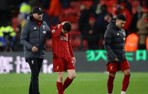Liverpool manager Jurgen Klopp and Andrew Robertson look dejected at the end of Saturday's defeat to Watford