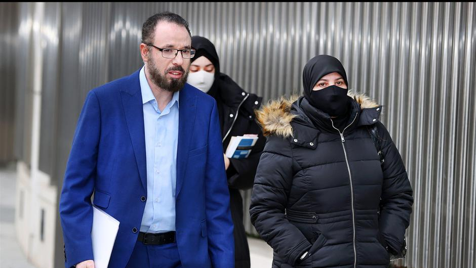 Azzam Raguragui's parents Abdul Raguragui (left) and Hajiba Elouaddaf (right) arriving at the Criminal Courts of Justice. (Photo by Steve Humphreys)