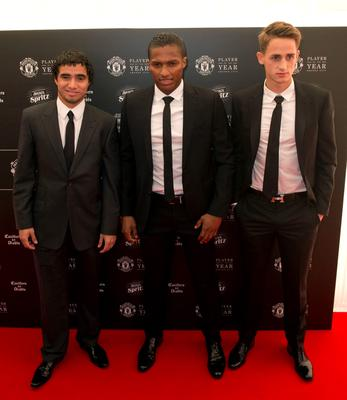 Manchester United's Brazilian defender Rafael (L), Manchester United's Ecuadorian midfielder Antonio Valencia (C) and Manchester United's Belgian midfielder Adnan Januzaj pose for pictures on the red carpet as they arrive to attend the 'Manchester United Player of the Year Awards' at Old Trafford stadium in Manchester, northern England, on May 19, 2015. AFP PHOTO / OLI SCARFFOLI SCARFF/AFP/Getty Images