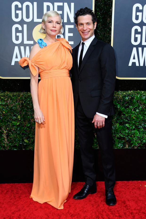 US actress Michelle Williams and Thomas Kail arrive for the 77th annual Golden Globe Awards on January 5, 2020, at The Beverly Hilton hotel in Beverly Hills, California. (Photo by VALERIE MACON / AFP)