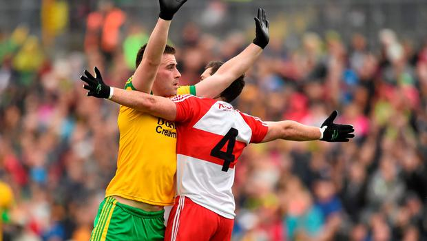 27 June 2015; Patrick McBrearty, Donegal, tussles with Dermot McBride, Derry. Ulster GAA Football Senior Championship, Semi-Final, Derry v Donegal. St Tiernach's Park, Clones, Co. Monaghan. Picture credit: Ramsey Cardy / SPORTSFILE