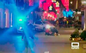 In this image made from video provided by CMM, people lay on the ground after a shooting at a Christmas market in Strasbourg, France, Tuesday, Dec. 11, 2018. (CMM via AP)