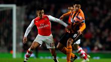 Alexis Sanchez of Arsenal battles for the ball with Curtis Davies of Hull City during the FA Cup Third Round match between Arsenal and Hull City at Emirates Stadium. Photo: Paul Gilham/Getty