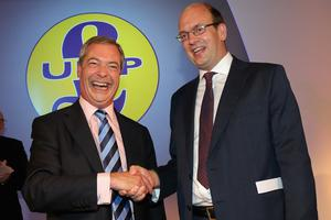 Conservative MP Mark Reckless is welcomed to UKIP by party leader Nigel Farage after the tory MP announced he was defecting on the second day of the UKIP party conference in Doncaster.  Party leader Nigel Farage declared that in the run up to next years general election UKIP will be targeting voters in Conservative and Labour heartlands.  Photo credit: Christopher Furlong/Getty Images