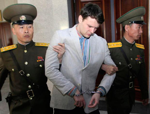 In this March 16, 2016, file photo, American student Otto Warmbier, center, is escorted at the Supreme Court in Pyongyang, North Korea.(AP Photo/Jon Chol Jin, File)