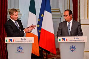 Irish Prime Minister Enda Kenny, left, and French President Francois Hollande attend a joint media conference at the Elysee Palace in Paris, France, Thursday, Sept. 3, 2015. (AP Photo/Michel Euler)