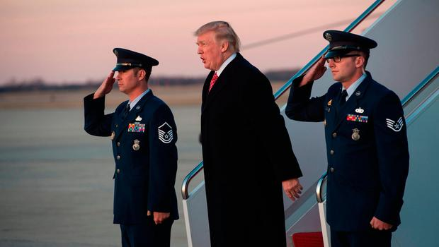 US President Donald Trump steps off Air Force One at Andrews Air Force Base in Maryland. / AFP PHOTO / NICHOLAS KAMMNICHOLAS KAMM/AFP/Getty Images