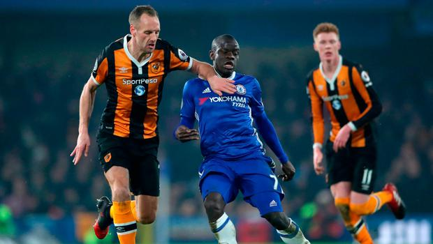 Chelsea's N'Golo Kante (right) and Hull City's David Meyler battle for the ball. Photo credit: Nick Potts/PA Wire