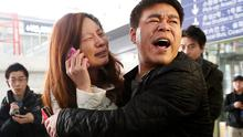 A relative of a passenger onboard Malaysia Airlines flight MH370 cries at the Beijing Capital International Airport
