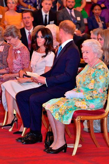 Queen Elizabeth II with the Duke and Duchess of Sussex at the Queen's Young Leaders Awards Ceremony at Buckingham Palace, London